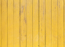Old Yellow Wooden Wall With Cracked Paint Layer