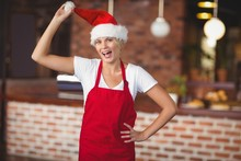 Pretty Waitress Touching Her Santa Hat