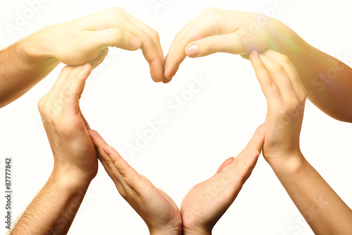 Fotografía  Heart formed by male and female hands on light background