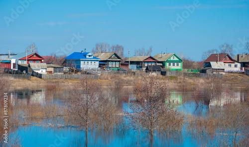 Poster Afrique du Sud Spring flood. Village on the banks of the river.