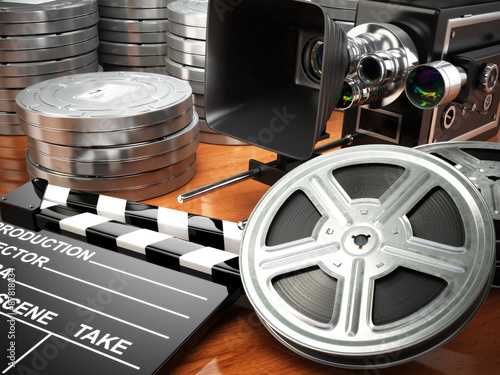 Photo  Video, movie, cinema vintage concept. Retro camera, reels and cl