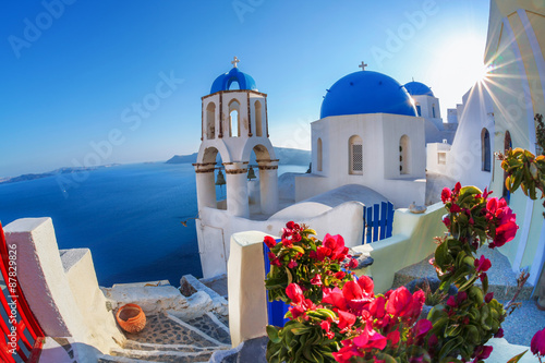 Santorini island with church against sunset in Oia, Greece