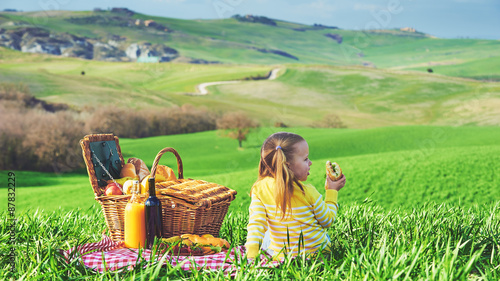 Foto auf Leinwand Picknick Little girl reversed back doing a picnic in the countryside of T