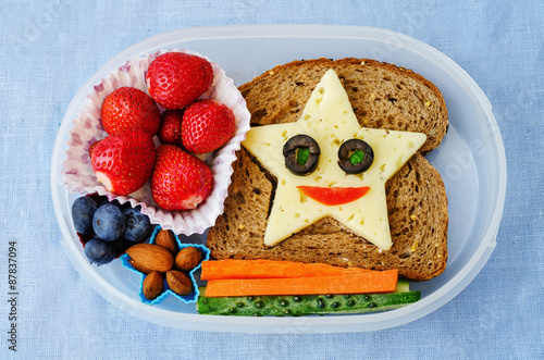 Poster Assortment school lunch box for kids with food in the form of funny faces