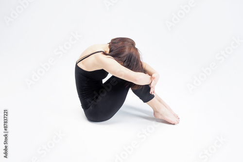 Fotografie, Obraz  athletic girl on white background, closed from all