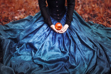 Snow White Princess With The Famous Red Apple. Girl Holds A Ripe