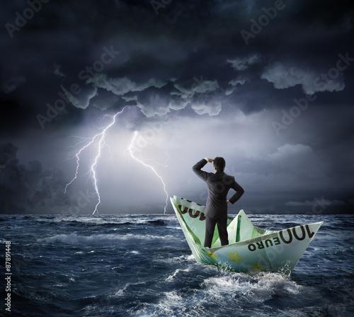 Fotografía  Euro boat in the crisis - investment risk concept