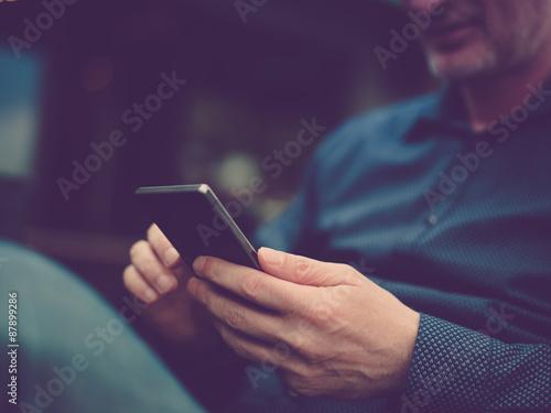 Fotografie, Obraz  Close up of a man using mobile smart phone