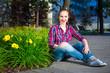 pretty girl sitting in summer park