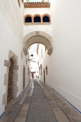 Obraz na Szkle Uliczki Old street in Sitges ,Catalonia,Spain