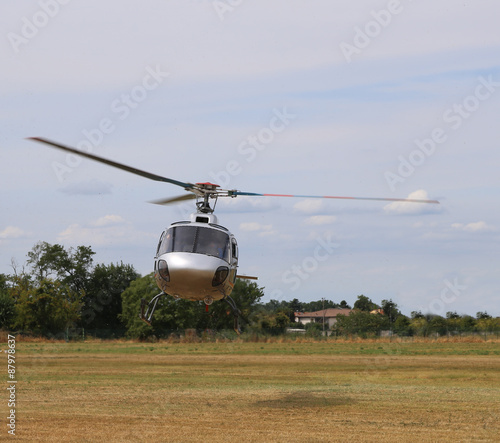 Staande foto Helicopter helicopter takes off from the airport to bring tourists over the