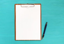 Blank Paper On Clipboard With Space On Blue Background
