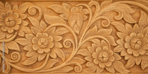 Valokuva  flower carved on wood