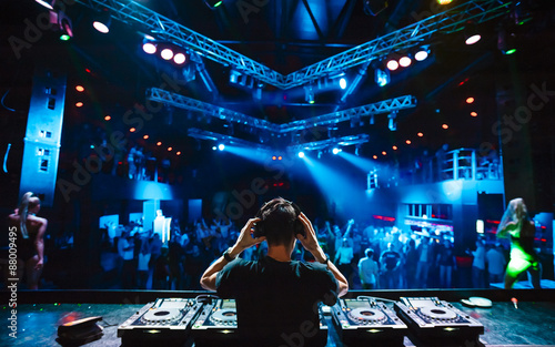 DJ with headphones at night club party Wallpaper Mural