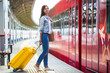 Young girl with luggage on the platform waiting for Aeroexpress