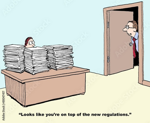 Fotografía  Business cartoon showing manager with desk stacked with papers and boss looking in and saying, 'looks like you're on top of the new regulations'