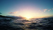 Floating in the Ocean Watching the Sunset in Slow Motion. Ocean Waves Rising and Falling.