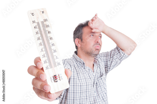 Fotografie, Obraz  Sumer heat and heatwave concept with man holding thermometer