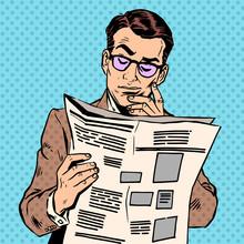 Man Reads A News Paper