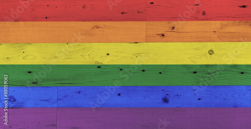gay pride rainbow flag pattern on wooden surface фототапет