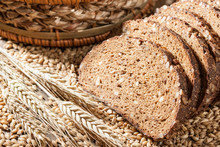 Rye Bread With Seeds On A Wooden Table