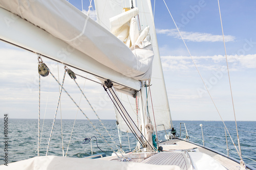 close up of sailboat mast or yacht sailing on sea