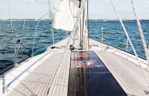 Poster Zeilen close up of sailboat or sailing yacht deck and sea