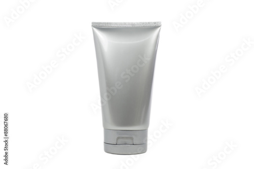 Fotografia  Silver cosmetic tube with transparent cap isolated and clipping