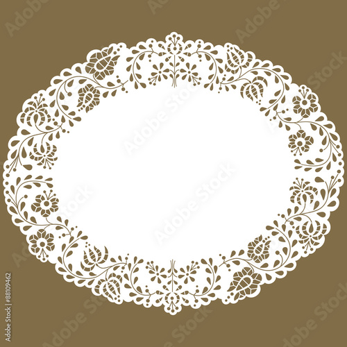 Valokuva  Oval paper lace edged doily made with Hungarian embroidery pattern
