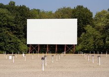 Retro Drive-In Movie Theater – A Drive-in Movie Theater With Speaker Poles.