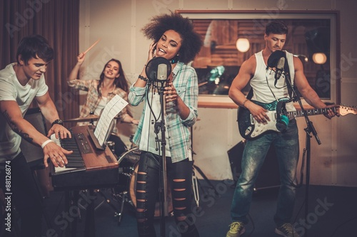 Fotografia Multiracial music band performing in a recording studio