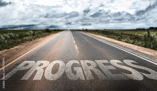 Photo Progress written on rural road