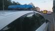 Closeup blue flashing police lights on top of patrol car, crime scene, emergency