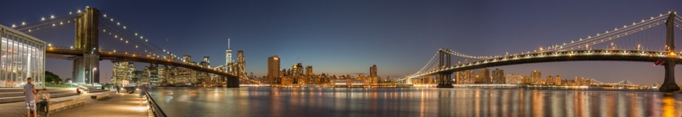 Panoramic View Manhattan Bridge, Brooklyn Bridge and Manhattan Skyline at night