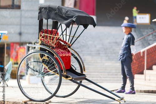Fényképezés  Japanese rickshaw man awaiting for the customers. Nagasaki