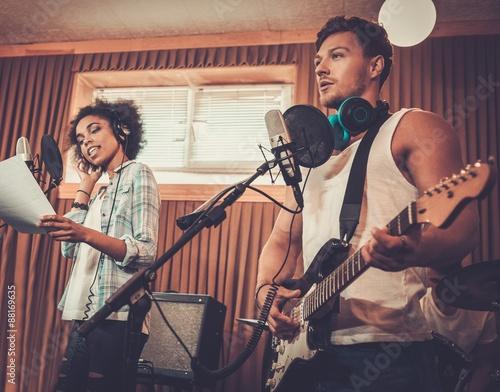 Keuken foto achterwand Muziekband Multiracial music band performing in a recording studio