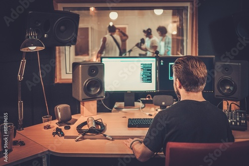 Valokuva  Music band during cd recording in studio
