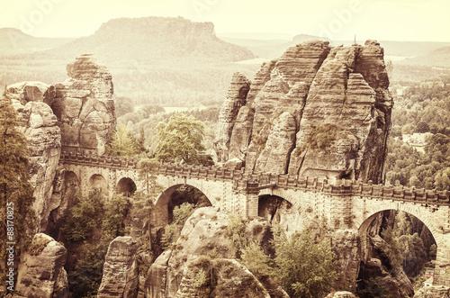 Old sepia postcard style Bastei bridge, Germany.