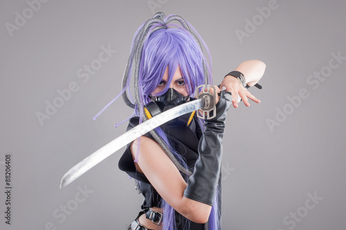 Photo  Female fantasy warrior / Female warrior with sword and gas mask isolated on the