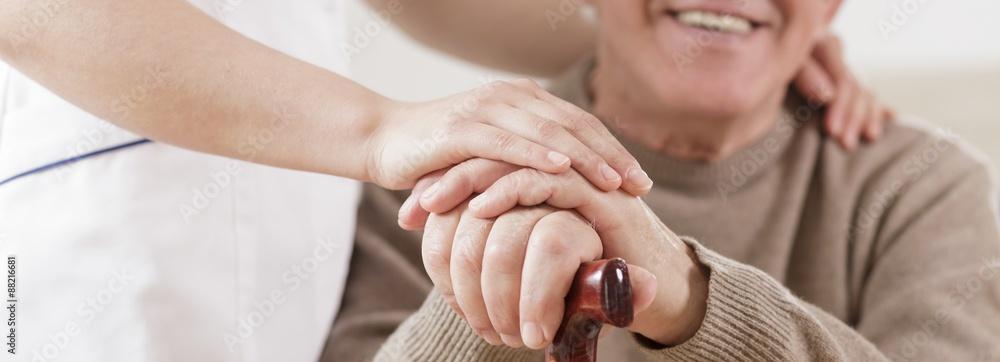 Fototapeta Senior man and caring nurse