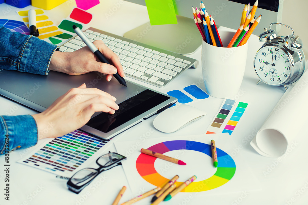 Fototapeta Young Handsome Graphic designer using graphics tablet to do his