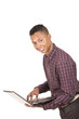 Young hispanic man with casual clothing carrying a laptop and