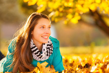 Beautiful Girl Lying In Autumn Leaves