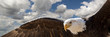 Leinwanddruck Bild - composite of a bald eagle flying in a cloudy sky