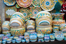Various Decorated Ceramic Dishes, Vases, And Bowls For Sale Outside A Souvenir Shop In Erice, Sicily