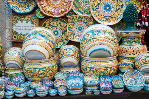 Fényképezés Various decorated ceramic dishes, vases, and bowls for sale outside a souvenir s
