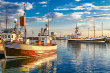 Traditional Old Fisherman Boats Lying In Harbor In Beautiful Golden Evening Light At Sunset, Iceland, Northern Europe