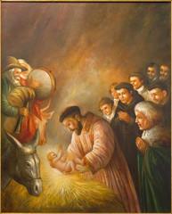 Fototapeta Do kościoła Cordoba - paint of st. Francis of Assisi in the scene of Nativity
