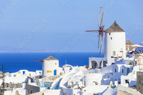Fototapeta Windmill and traditional houses, Oia, Santorini (Thira), Cyclades Islands, Aegea