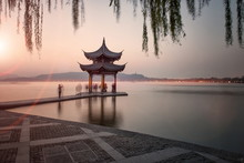 Visitors Are Taking The Last Shots With A Pagoda At West Lake As The Sun Is Sinking, Hangzhou, Zhejiang, China
